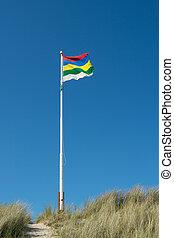 Flag in the wind on Dutch wadden island Terschelling
