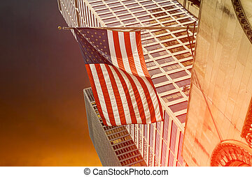 Flag flying in front of a corporate office building