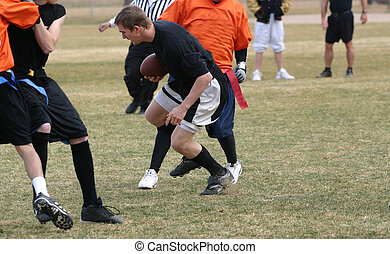 Flag Football - A group of young men playing flag football...