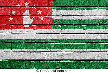 Flag of Abkhazia on brick wall