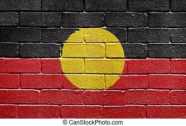 Flag of Aborigines on brick wall