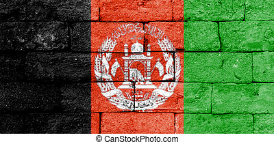 Flag of Afghanistan on old brick wall.