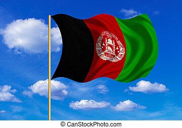 Flag of Afghanistan waving on blue sky background