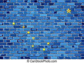Flag of Alaska on a brick wall