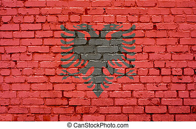 Flag of Albania painted on brick wall, background texture