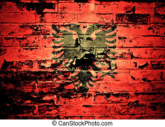 flag of Albania painted on brick wall