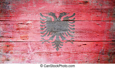 Flag of Albania painted on grungy wood plank background