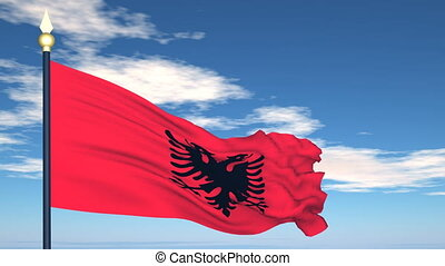 Flag Of Albania on the background of the sky and flying...