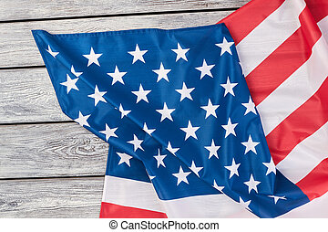 Flag of America on wooden background, top view. USA...