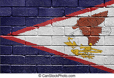 Flag of American Samoa on brick wall