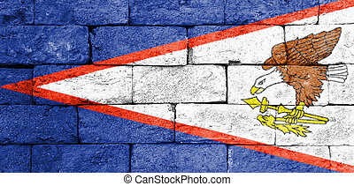 Flag of American Samoa on old brick wall.