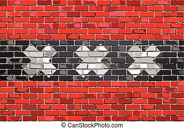 Flag of Amsterdam on a brick wall