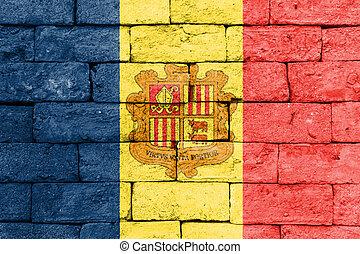 Flag of Andorra on old brick wall.