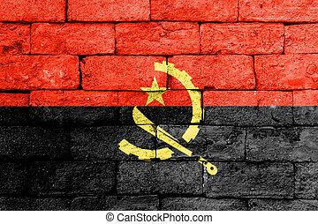 Flag of Angola on old brick wall.