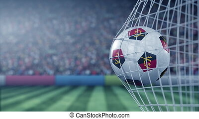 Flag of Angola on the football hitting goal net back. Realistic slow motion 3D animation