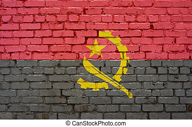 Flag of Angola painted on brick wall, background texture