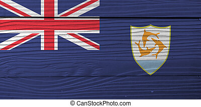Flag of Anguilla on wooden wall background. Grunge Anguilla flag texture, Blue Ensign with the British flag and the coat of arms of Anguilla in the fly.