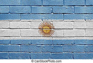 Flag of Argentina on brick wall