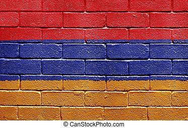Flag of Armenia painted onto a grunge brick wall