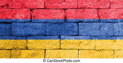 Flag of Armenia on old brick wall.