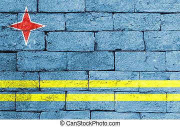 Flag of Aruba on old brick wall.