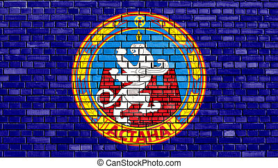 flag of Astana painted on brick wall