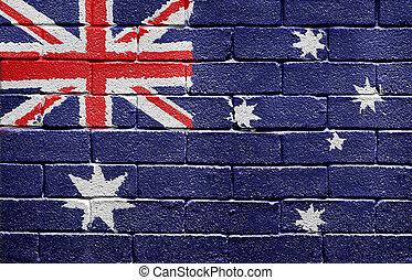 Flag of Australia on brick wall