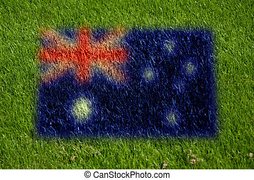 flag of australia on grass with spray