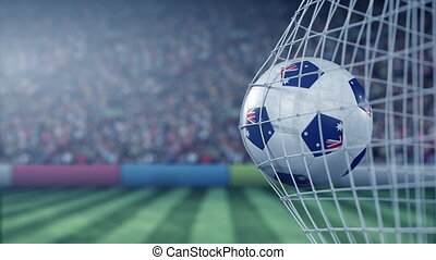 Flag of Australia on the football hitting goal net back. Realistic slow motion 3D animation