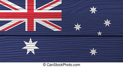 Flag of Australia on wooden wall background. Grunge Australian flag texture, blue red and white color with white star and Union Jack.