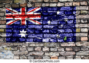 Flag of Australia painted on an old brick wall with small...