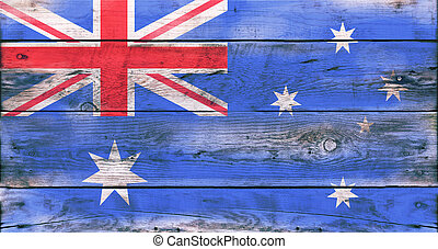 Flag of Australia painted on grungy wood plank