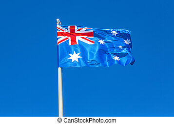 Flag of Australia waving in the wind against the sky