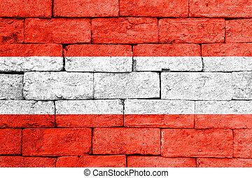 Flag of Austria on old brick wall.