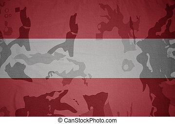 flag of austria on the khaki texture . military concept