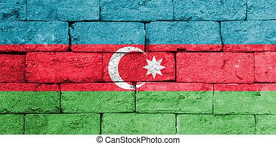 Flag of Azerbaijan on old brick wall.
