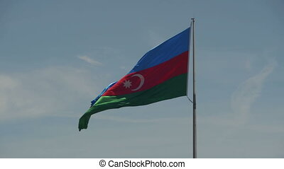 Flag of Azerbaijan on the Flagpole Waving in the Wind...