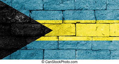 Flag of Bahamas on old brick wall.