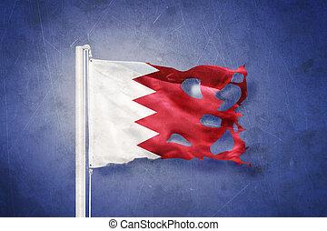 Flag of Bahrain flying against grunge background