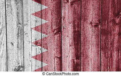 Flag of Bahrain on weathered wood