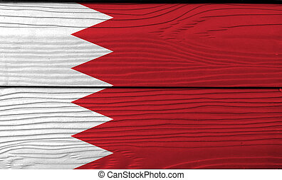 Flag of Bahrain on wooden wall background. Grunge Bahrain flag texture, five white triangles in the form of zigzag on red field.