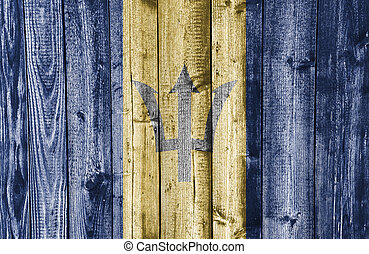 Flag of Barbados on weathered wood