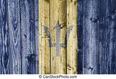 Flag of Barbados on weathered wood