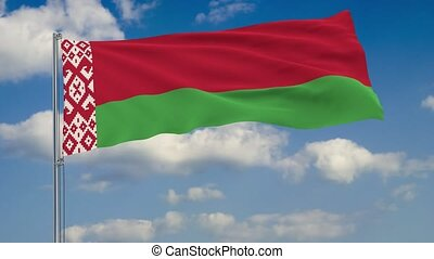 Flag of Belarus against background of clouds