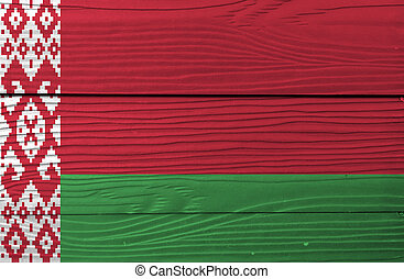 Flag of Belarus on wooden wall background. Grunge Belarus flag texture, red over green in a 2:1 ratio, with a red ornamental pattern on a white vertical stripe at the hoist.
