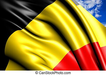 Flag of Belgium against cloudy sky. Close up.