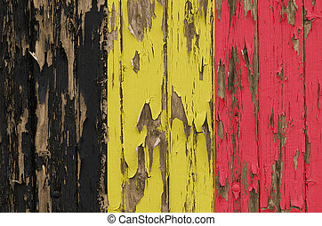 Flag of Belgium on a weathered wooden wall