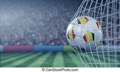 Flag of Belgium on the football hitting goal net back. Realistic slow motion 3D animation