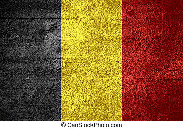 flag of Belgium or Belgian banner on rough texture