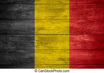 flag of Belgium or Belgian banner on wooden background